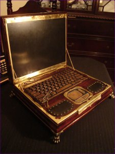 laptop with steampunk brass fittings