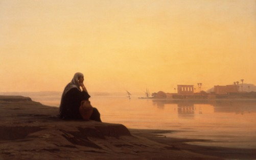 """""""Philae"""" oil painting by Veillon, a woman sitting on a riverbank at sunrise with temples and palm trees in the distance"""