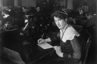 Helen Campbell, a wireless operator, at her desk in 1917
