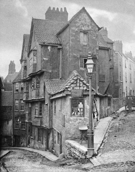 a street corner in a Victorian city - Steep Street, Bristol, 1866