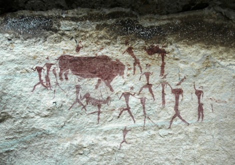 cave painting of human figures and animal figures by san bushmen