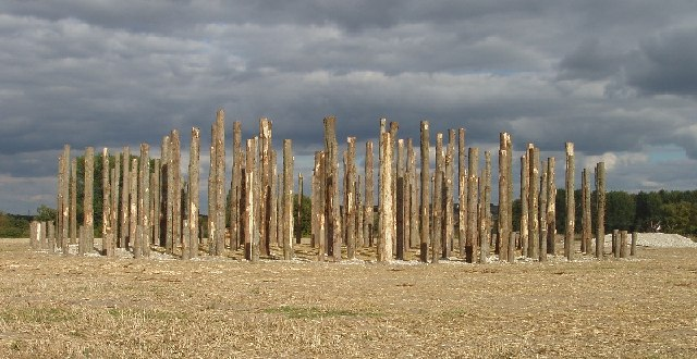photo of a recreation of woodhenge, standing tree trunks in a circular pattern on moorland