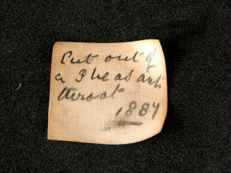 """Paper label """"cut out of pheasants throat 1887"""""""