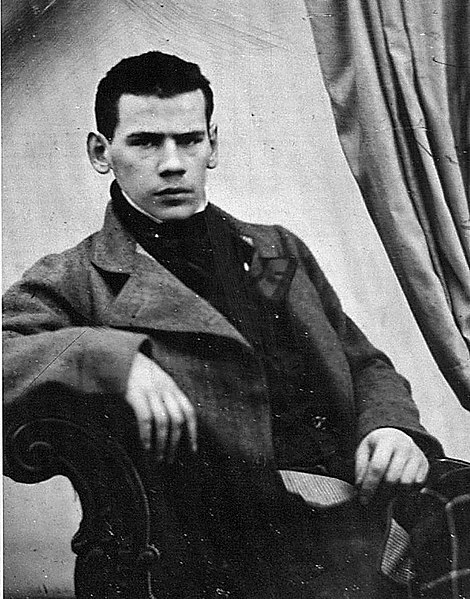 Leo Tolstoy, 1848 - young man seated, facing the camera