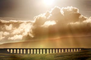 ribblehead viaduct in sunshine through clouds (c) Michael Bryan